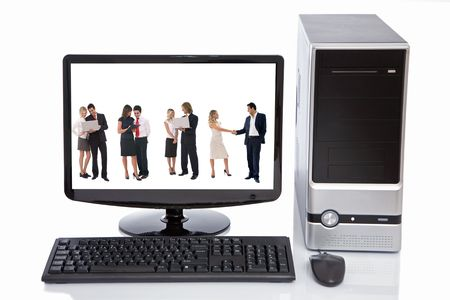 high tech lcd, desktop, keyboard, and mouse with business people concept Stock Photo