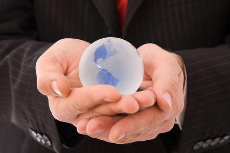 Young businessman holding globe, on white background Stock Photo - 5351400