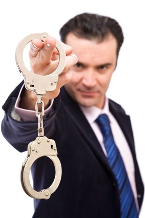 Confident detective with handcuffs on white background Stock Photo