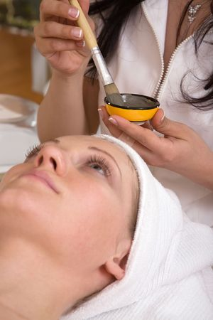 face care concept with a beautiful woman at the spa