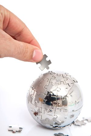 globe puzzle: Mini world close up on white, shallow dof, space for messages
