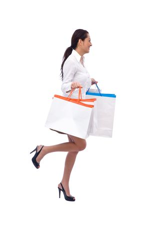Beautiful girl with shopping bags on white background photo