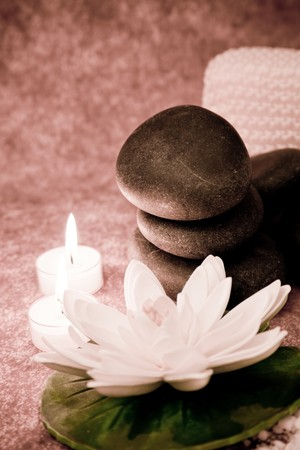stones with flower: lastone concept with volcanic stones, flower and candles