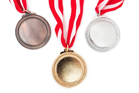 medals with red ribbon on white background photo
