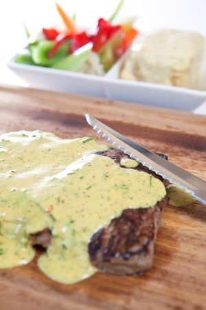 T bone steak garnished with  roquefort sauce photo