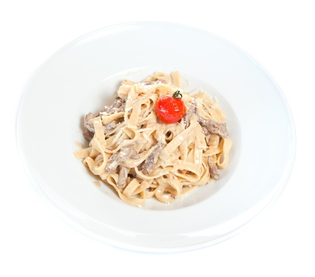Chicken fettuccine  garnished with cherry Stock Photo - 8391100