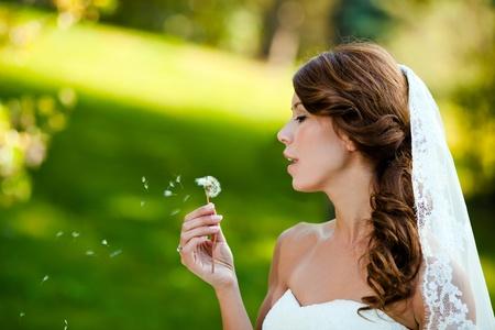 beautiful bride close up portrait at a park