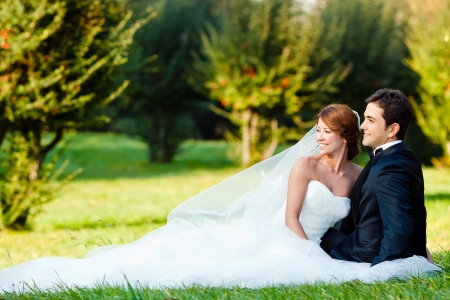 groom and bride: happy bride and groom at a park on their wedding day Stock Photo