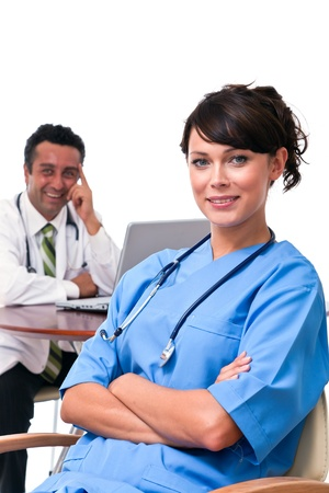 Nurse sitting with doctor in clinic photo