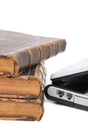 Old legal books with modern laptop on white background photo