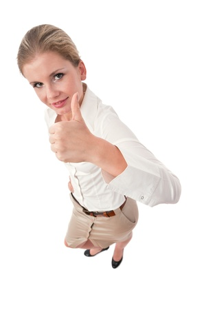 Young business executive cheering with clenched fist photo