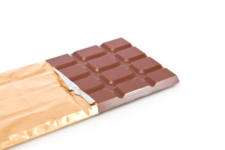 Chocolate bar in wrapper isolated on white background photo