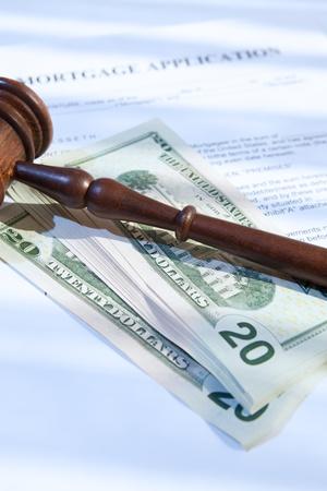 mortgage application, gavel and us dollars photo
