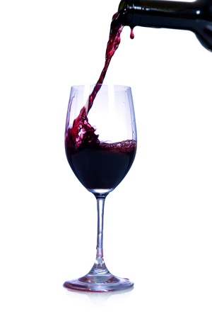Red wine pouring from bottle Stock Photo - 8740083