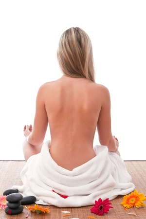 Nude women sitting in spa with towel around her waist Stock Photo