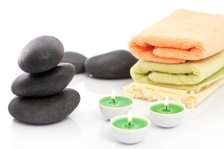 Therapeutic stones with towels and candles in  spa photo