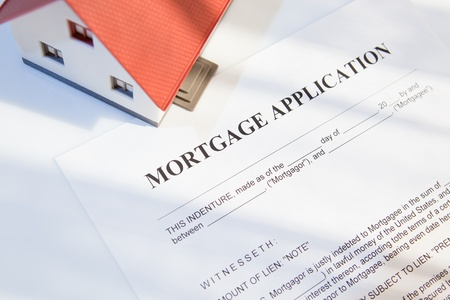 mortgage application form with a mini house for real estate photo