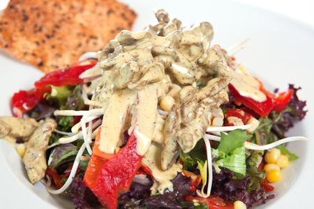 Salad garnished with sauce and nacho Stock Photo - 8744393