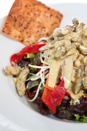 nacho: Salad garnished with sauce and nacho