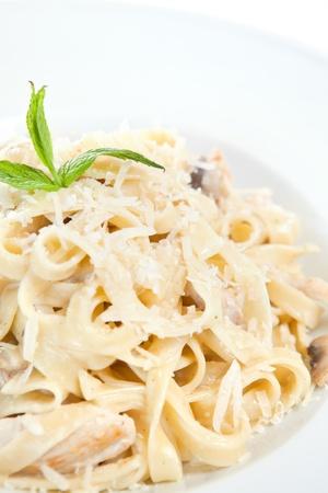 fettuccine: Chicken fettuccine alfredo in a plate