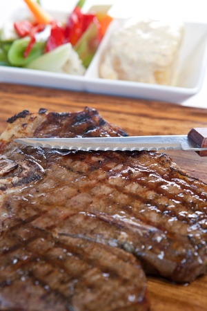 Grilled  steak with knife  photo