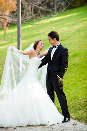happy wedding couple at a park on a sunny day Stock Photo