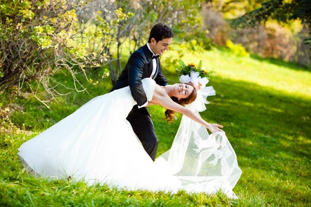 dancing wedding couple at a park on a sunny day Stock Photo - 8744379