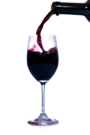 Red wine pouring from bottle Stock Photo - 17037035