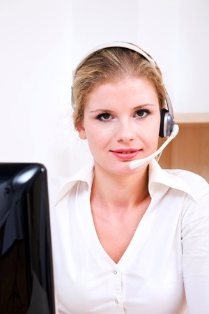 Beautiful call center operator working at the modern office photo