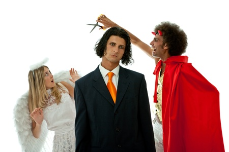 devil and angel fighting for a young businessman Stock Photo