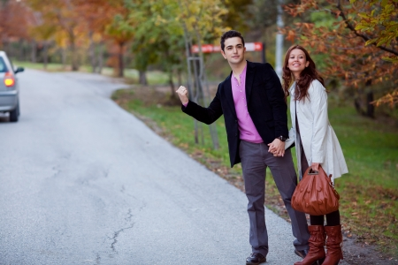 young couple travelling via hitchhike