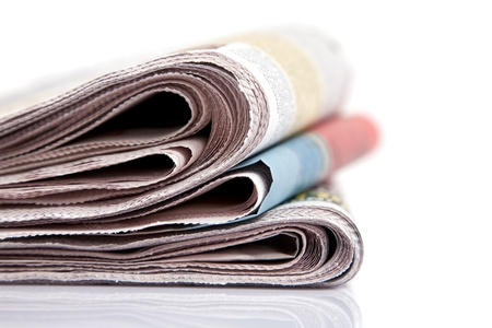 newspaper close up on white background, shallow dof Stock Photo - 17129320