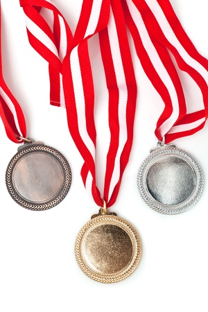 silver medal: Gold, silver and bronze  medals  with ribbons Stock Photo