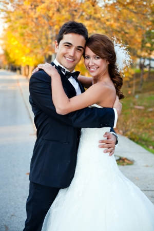 wedding portrait: happy bride and groom at a park on their wedding day Stock Photo