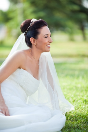 beautiful wedding bride with sitting on garden