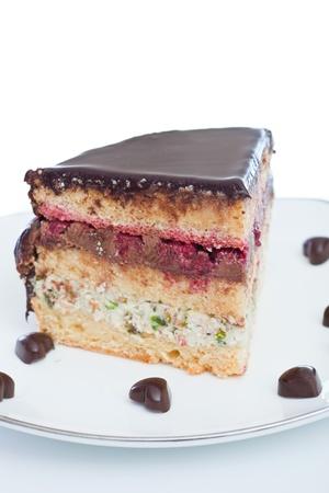 sweet chocolate cake close up on white background