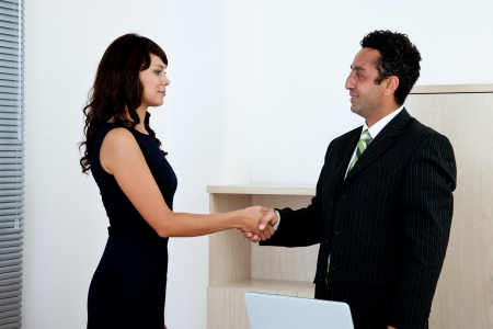 business agreement concept with businesswoman and businessman handshake Stock Photo