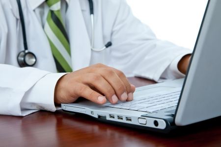 medical doctor at hospital with laptop and stethoscope, shallow dof
