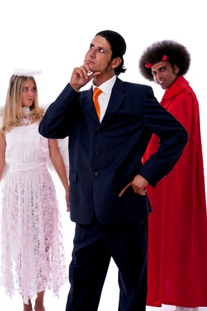 young businessman ready to decide with his angel and devil photo