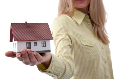 real estate concept with a woman holding a mini house Stock Photo