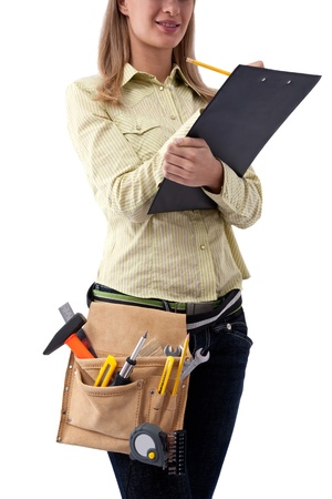 young businesswoman with construction tools on white background