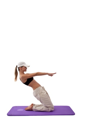 young girl doing yoga for a healthy life on white Stock Photo