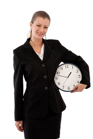 time concept in business with a clock and businesswoman