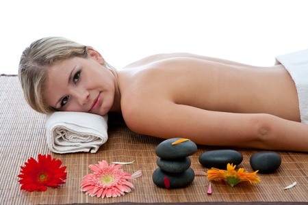 young woman having a lastone massage therapy photo