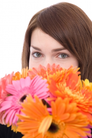 beautiful young woman with lots of colorful daisy flowers Stock Photo
