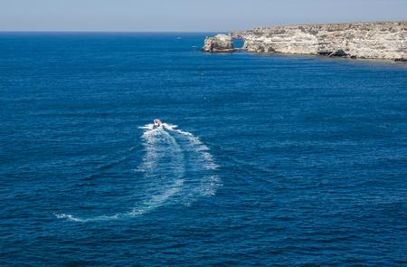 The boat on the blue sea Banco de Imagens