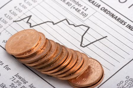 Coins Over Charts close up Stock Photo - 512471