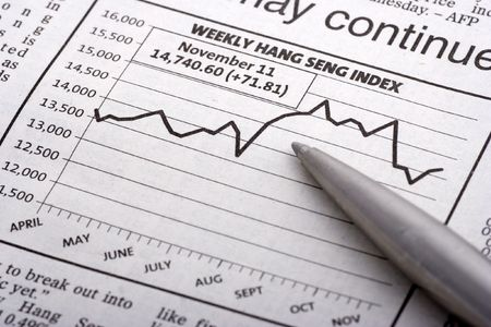corporate greed: Pen Over Chart close up