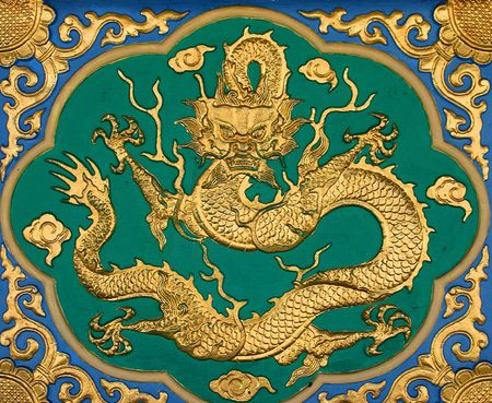 Chinese golden dragon at the wall. Stock Photo