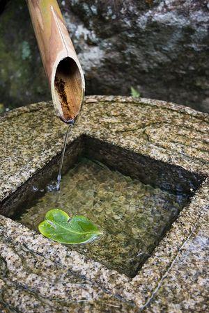 bamboo fountain: Japanese bamboo fountain. Stock Photo
